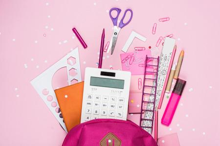 Photo pour various school supplies in schoolbag - image libre de droit