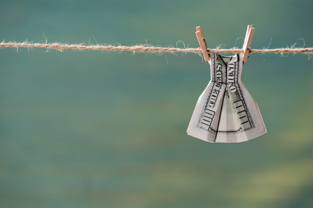 Photo pour close up of one hundred us dollar banknote on clothesline - image libre de droit