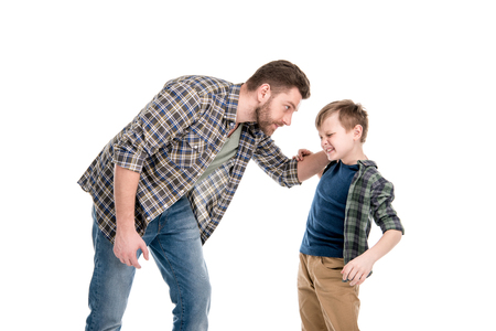 Foto de Father threatening and quarreling with little son - Imagen libre de derechos