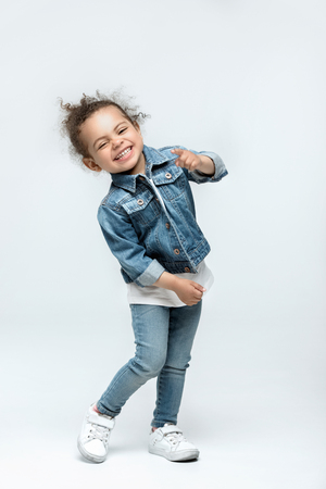 Photo for funny little kid girl in jeans - Royalty Free Image