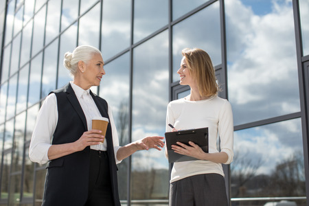 Photo for businesswomen on meeting outdoors near office building - Royalty Free Image