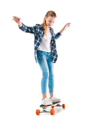 Photo pour happy girl with skateboard isolated on white in studio - image libre de droit
