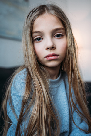 Photo for portrait of pensive little girl in pajamas looking at camera - Royalty Free Image