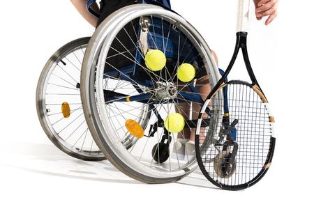 Foto de partial view of tennis player sitting in wheelchair isolated on white - Imagen libre de derechos