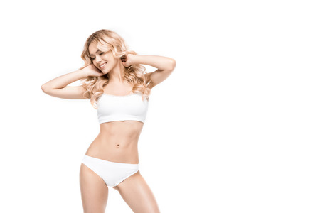 Photo pour attractive smiling woman standing in white underwear - image libre de droit