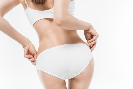 Photo pour woman in white underwear showing her butt isolated on white - image libre de droit