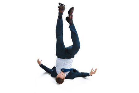 Photo for young businessman in suit falling upside down - Royalty Free Image