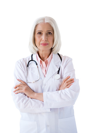 Photo for confident senior doctor looking at camera with crossed arms - Royalty Free Image