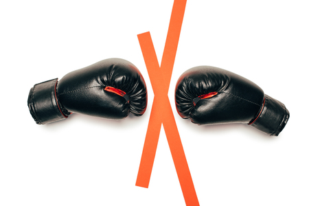 Foto de Pair of black boxing gloves ready to fight isolated on white - Imagen libre de derechos