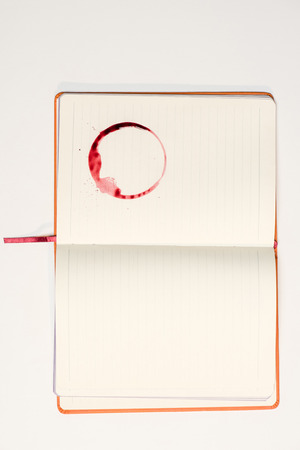 Photo for blank notebook with red wine stain - Royalty Free Image