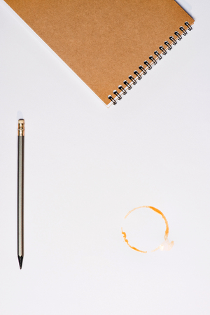 Photo for notebook with pencil and coffee stain isolated on white - Royalty Free Image