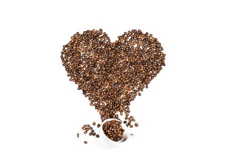 Foto de White cup and heart symbol made from coffee seeds - Imagen libre de derechos