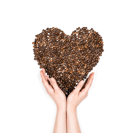 Photo for Human hands making heart symbol made from coffee seeds - Royalty Free Image