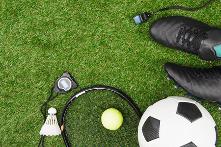 various sport equipment on green grass