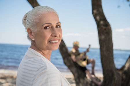 Photo for senior lady smiling and looking at camera outdoors - Royalty Free Image