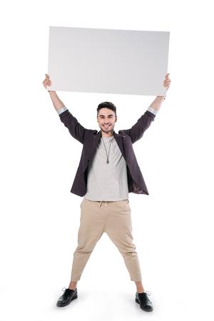 Photo pour young caucasian man holding blank board - image libre de droit