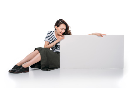 Foto de asian woman sitting and holding blank board - Imagen libre de derechos