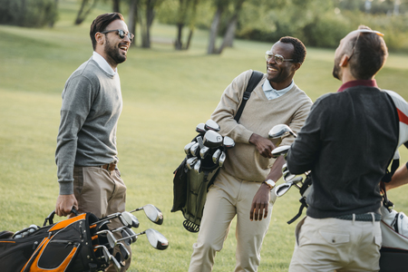 Photo for golf players with golf clubs having fun on golf course - Royalty Free Image