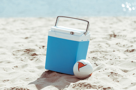 Photo for cooler box and volleyball ball on sandy beach - Royalty Free Image