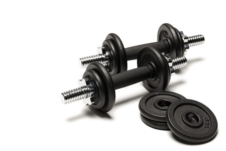 Photo pour iron dumbbells with weight plates isolated on white - image libre de droit