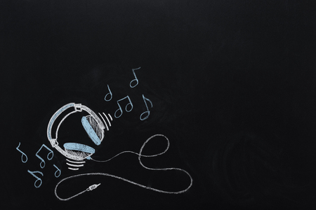 Foto de headphones with wire and musical notes drawn - Imagen libre de derechos