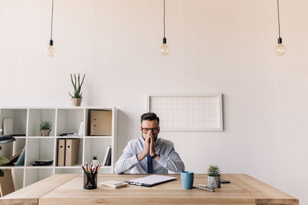 Photo for bearded businessman sitting at table in modern office - Royalty Free Image