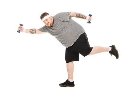 Photo for young obese man running with dumbbells and looking at camera - Royalty Free Image