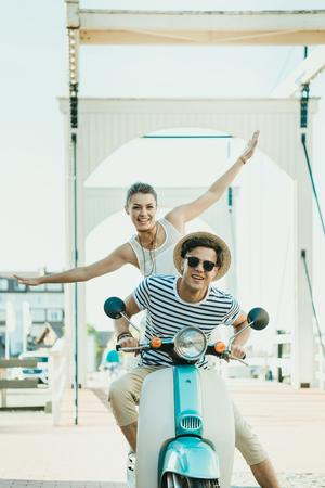 Foto de couple in love riding retro scooter together - Imagen libre de derechos