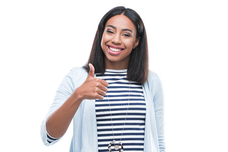 Photo pour african american woman showing thumb up and smiling at camera - image libre de droit