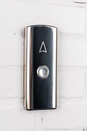 Photo pour elevator button up direction on white wall - image libre de droit
