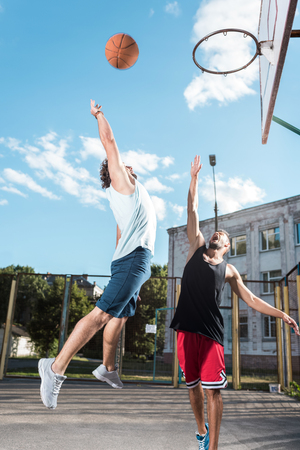 Photo pour basketball players playing basketball together on court - image libre de droit