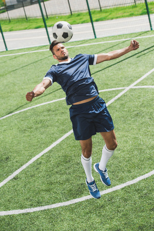 Photo pour athletic soccer player training with ball on soccer pitch - image libre de droit