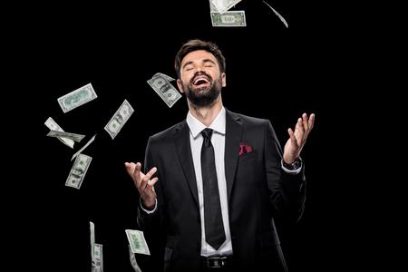 Foto de handsome rich excited businessman throwing dollar banknotes, - Imagen libre de derechos