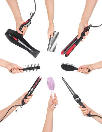 Photo pour hands holding hairdressing tools - image libre de droit