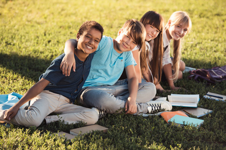 Photo for multiethnic teenagers studying in park - Royalty Free Image