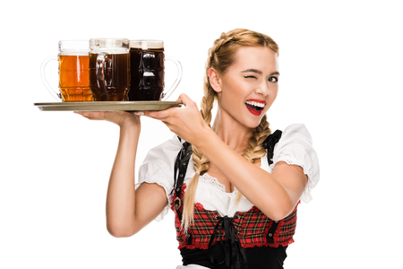 Photo pour winking waitress with beer glasses - image libre de droit