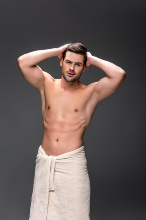 Photo pour man covering with towel after shower - image libre de droit