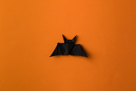 Photo for black halloween origami bat, isolated on orange - Royalty Free Image