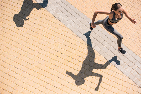 Photo for woman jogging on street - Royalty Free Image