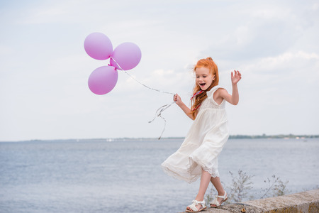 Photo for child with balloons on quay - Royalty Free Image