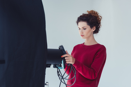 Photo for female photographer with softbox - Royalty Free Image