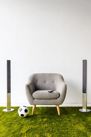 Photo for Armchair with remote controller, ball and loudspeakers - Royalty Free Image