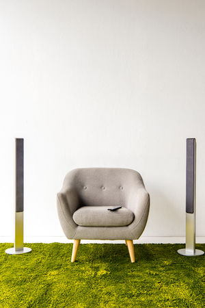 Photo for Armchair with remote controller and loudspeakers - Royalty Free Image