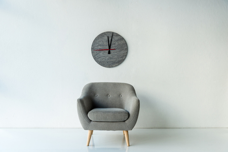 Photo pour Armchair and clock - image libre de droit