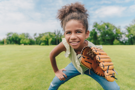 Photo for child playing baseball in park - Royalty Free Image