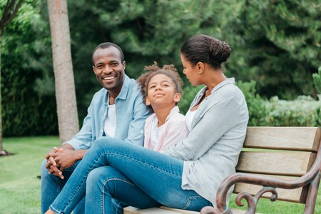 Photo for african american family resting on bench - Royalty Free Image