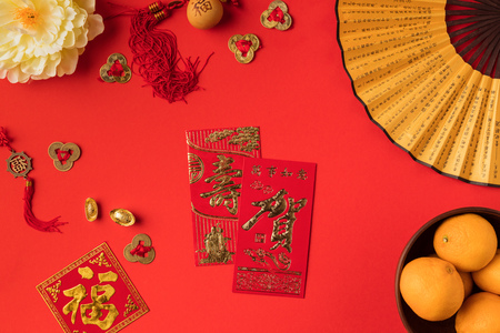 Photo for top view of festive chinese decorations and tangerines isolated on red - Royalty Free Image