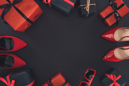Photo for top view of red heels and presents, isolated on black with copy space - Royalty Free Image