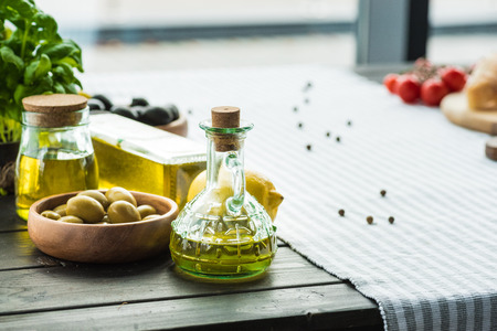 Photo for olive oil bottles with vegetables - Royalty Free Image