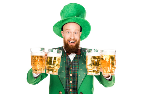 Photo for excited leprechaun celebrating st patricks day with glasses of beer - Royalty Free Image